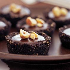 These bite-size tarts are a chocolate lovers dream! Recipe: http://www.bhg.com/recipe/desserts/chocolate-crusted-chocolate-tarts/?socsrc=bhgpin072212chocolatetart