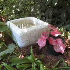 Recycle a styrofoam cooler by using QUICKWALL concrete to coat the surface - this creates a lightweight but sturdy trough-style planter to use in the garden. via Dave's Garden.