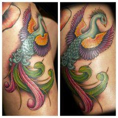 beautiful bird tattoo done by Megan Massacre