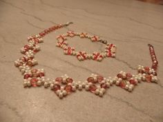 Elements  in pearl and red/orange  pattern from Bead & Button online beaded by Karla Krohn