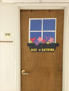 Easy college dorm decor/decorating ideas for door: Spring-- construction paper window and flowers.