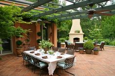 Mediterranean Design - large patio with dining & seating area