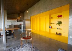 Jakob Gomez renovates Monterrey apartment with yellow section