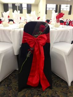 Love is in the air! ❤ Our modern Black/White Spandex chair covers and Red Crinkle Taffeta Sashes for a beautiful Valentines party! #rose #party #romantic #red #decoration #wedding #bridal #rental #linens #chaircover #sash www.bayarealinens.com