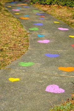 Use heart-shaped sidewalk chalk stencils to make a colorful walkway! <3