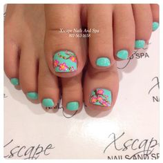 Pretty pedicure: a light turquoise with pink/yellow flowers and vines