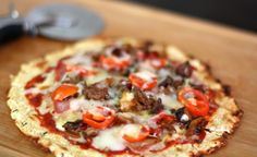 """pizza with a cauliflower """"crust"""".  i thought i hated cauliflower but i think it is officially on its way to changing my life."""
