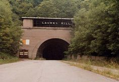 This is the Laurel Hill Tunnel, a remarkable feature of the original Pennsylvania Turnpike.  Originally the vision of a railroad man, the tunnel was begun with picks and shovels in the 1800s, but the work stopped short when the railroad project fell through.  It would be left to the Pennsylvania Turnpike Commission to finish the task 55 years later.  Eleven men gave their lives to complete the marvel of modern engineering but it outlived its usefulness after only 24 years.