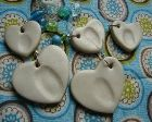 Heart-shaped pendants with kids' fingerprints in the middle. Would make great Mother's and Father's Day gifts!