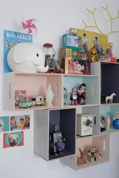 Ikea hack: Display storage for the kiddos (Try the Ikea Prant Box. They are easy to paint and can put one of these walls together under $100.)