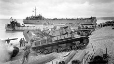 WWII Tanks on normandy beach 1944.