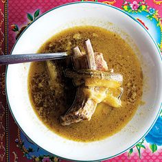 A spicy, fruity tomatillo sauce offsets the richness of bone-in pork ribs in this luscious dish from the state of Puebla.