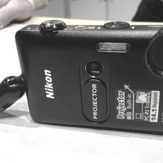 Nikon-- This camera has a projector that plays movies and videos-- talk about instant sharing!