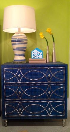 Style Spotter Michelle Jennings Wiebe visited HGTV HOME and Style Spotted the HGTV HOME Furniture Blue Raffia Chest.  Digging the #HGTV Accent Drawer Chest in blue raffia with polished #chrome #nailheads. Perfect as a #bedroom #nightstand or #foyer entry piece. #Bassett #HGTV #HomeCollection #IHFC-C1200 #HPMKT