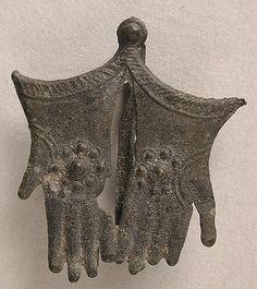 Pilgrim Badge, Thomas A'Becket's Gloves, 15th century, Bury St. Edmunds, England, tin and pewter.