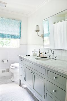 gray console vanity, blue and white bathroom