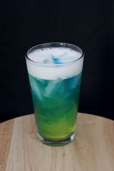 Alien Urine Sample (1/2 shot coconut rum 1/2 shot melon liqueur 1/2 shot banana liqueur 1/2 peach schnapps 2 shots sweet & sour juice soda water 1/2 shot blue curaçao)