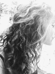 Naturally curly hair, half up.