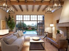 pool, light fixtures, steel windows, wood beams