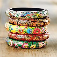"Kashmiri Floral Bangles - Set of 5 Papier-mâché developed into a fine art during the Persian rule of India. Artisans in the mountainous Kashmir region use papier-mâché to embellish everything from jewelry to decorative boxes to furniture. Master artisans use rich pigments and gold accents to hand paint these lightweight bangles with traditional paisley, floral, and bird patterns. Handcrafted in Kashmir. 2 3/4"" diameter."