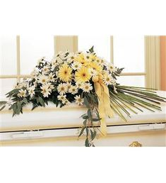 Drop of Sunshine Casket Spray #casketspray #funeralflowers  $79.16