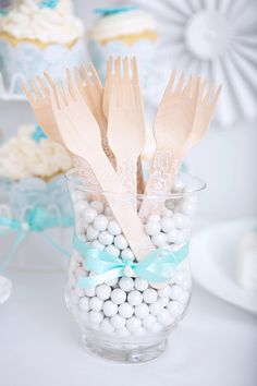 lace wooden utensils by Sugar Coated Studio http://www.weddingchicks.com/2013/09/04/blue-and-white-cake-table/