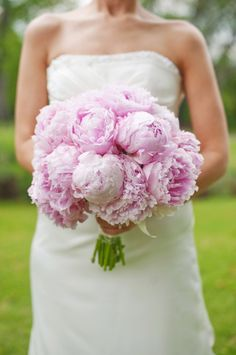 perfect peony bouquet, photo by Dixie Pixel Photo http://ruffledblog.com/romantic-vintage-tennessee-wedding #flowers #weddingbouquet #peonies