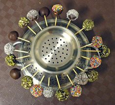 Colander= cake pop drying stand, genius for anything on a stick. BRILLIANT!