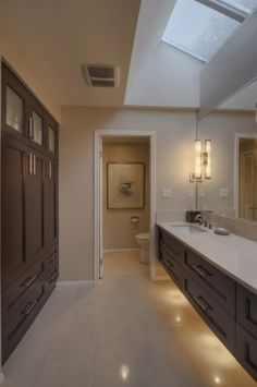 vanity on one wall, storage on the other! I want this bathroom!
