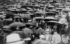 Spectators sit under umbrellas during a rainy University of Michigan commencement in 1934. (Detroit News Archives)