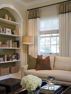 love the olive in the bookcase with the little bit of burnt orange on the pillow