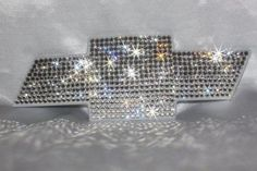 Blinged out Chevy emblem or any vehicle emblem! You can send in your own or order.  Starting at $75