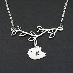 Initial Necklace Personalized jewelry twig with by earringsnation, $19.80- would be great to have with two birds with Noah and Caleb's initials.