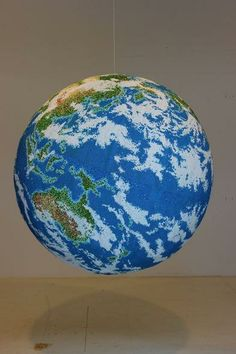 Artist Andy Yoder spent two years meticulously assorting 300,000 matchsticks into the shape of Earth.