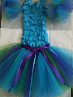 Deluxe Tinkerbell Tutu Set,   Bottom: Deluxe Very Full Tutu Skirt Turquoise,Kelly Green and Purple Tulle    Top: Deluxe Turquoise Lace Petti Top     Arm Bands: Pagent Syle Deluxe Tutu Arm Bands    Sizes Available: 3months thru 6