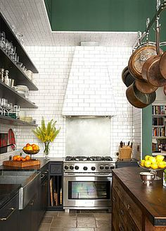 white painted brick and open shelving