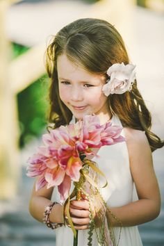oversized dahlia bouquet for the flower girl // photo by Connection Photo // http://ruffledblog.com/glittery-outer-banks-wedding