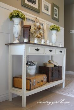 entry way table, love the little suitcase