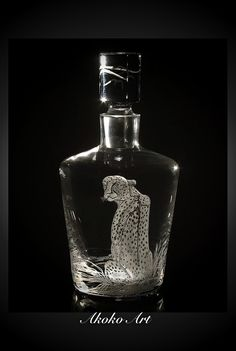 Elegant Owen decanter handmade glass handmade in Krosno Poland. Has an individually fitted stopper.Patient cheetah. $255.00, via Etsy.