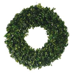 Add natural appeal to the entryway or kitchen with this preserved boxwood wreath, perfect for bringing an organic touch to your decor.