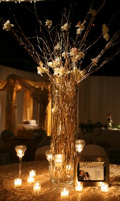 Curly willow sticks in clear vases as centerpieces... LOVE! Surrounded by flickering candles.. This is so perfect for the fall evening wedding.