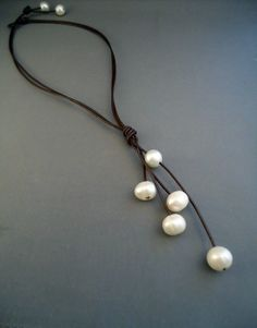 leather and  Pearls pouring Necklace by iseadesigns on Etsy, $43.99