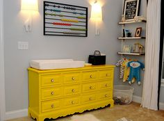 Modern Yellow, Grey, White & Black nursery... I'm OBSESSED with this dresser tho! :) Thinking about something like this for our new Master Bedroom!!!