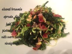 Raw brussels sprouts, dino kale and toasted pistachios tossed with a warm bacon vinaigrette-the perfect winter salad!