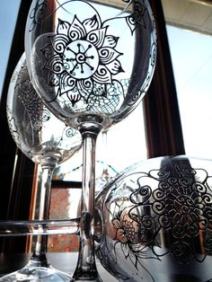Artisan hand painted wine glasses in Henna style designs. One of a kind gift. Mehndi Glass via Etsy
