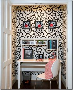 Looooove this wallpaper, and for a closet office!  This is totally the type of visual distraction I need in my workspace (really.)!
