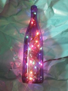 Blue wine bottle luminary with rainbow lights