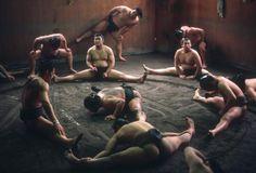 JAPAN. Tokyo. 1985. Sumo wrestlers of the Dewanoumi Beya sumo stable do daily exercises in training camp. © Burt Glinn/Magnum Photos