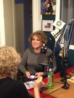 Carole in studio at WYXC talking to Melissa on air