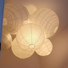 Create Apartment Therapy's DIY lantern chandelier with paper lanterns from http://www.partylights.com/Lanterns.